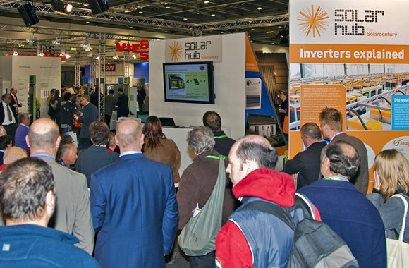 Visitors looking at exhibits at the Ecobuild Solar Hub, designed and delivered by Focal Point