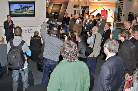 Delegates listening to a presentation at the Ecobuild Solar Hub, designed and delivered by Focal Point