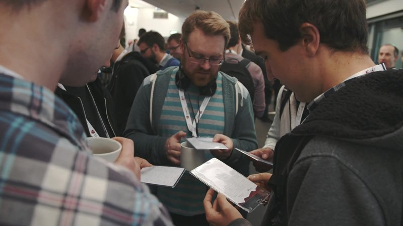 Bristech 2015 delegates looking at their event badges